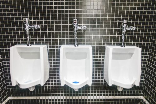 White Urinal on Back Tiles Wall